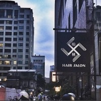 """Nazi"" swastika-like logo. (Photo from Berlin Hair Salon Instagram)"