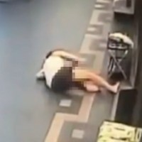 Surveillance footage of landlord on the ground. (New Taipei Police)