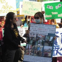 Migrant worker rally in Taipei calls for end to onsite factory dorms