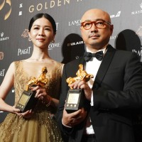 Hsieh Ying-xuan, left, and Xu Zheng with awards for Best Leading Actor and Actress at 55th Golden Horse Awards