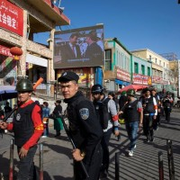 China urges 'extremists' in Xinjiang to surrender with new 18-point crime list