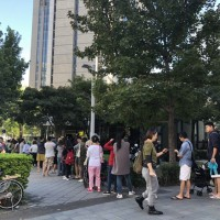 Long queues on election day elicit complaints from voters