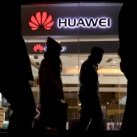 Huawei logo in background.