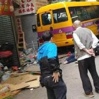 Runaway school bus in Hong Kong kills 2, injures 14