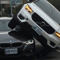 Video shows Taiwanese woman drive Volvo over husband's BMW with 'mistress' inside