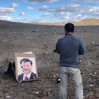Video shows Kazakh man 'glad to shoot' photo of Xi Jinping