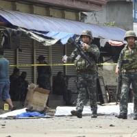 Philippine troops battle Muslim militants after church blast