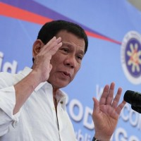 Philippines' Duterte calls for peaceful resolution of China boats impasse