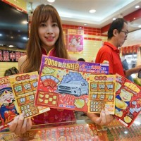 Taipei couple scrapes their way to NT$20 million scratch card jackpot