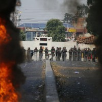 Maduro's opponents brave tear gas in push to deliver aid to Venezuela