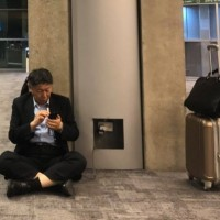 Taipei mayor criticized for sitting on floor of Israel airport to charge phone
