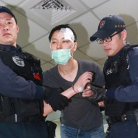 Chinese-American man shouts 'Trump save me' after tossing wife off Taiwan airport stairway
