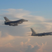 Taiwan F-16 and PLAAF H-6K bomber (Photo from MND)