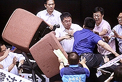 House of flying sofa chairs: Taiwan legislature sees second day of violence
