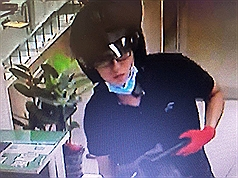 Taiwanese police release photos of suspect robbing Chang Hwa Bank